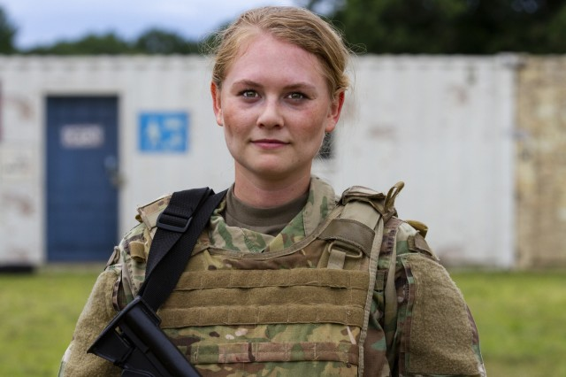 Spc. Alexandra Vanoverbeke, a U.S. Army Reserve psychological operations specialist with the 13th Psychological Operations Battalion, from Arden Hills, Minnesota, poses for a photo shortly after working through the training lanes for a combat lifesaver course at Fort McCoy, Wis., July 18, 2019.