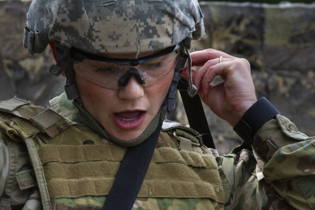 Spc. Alexandra Vanoverbeke, a U.S. Army Reserve psychological operations specialist with the 13th Psychological Operations Battalion, from Arden Hills, Minnesota, calls out medical information to her partner during a combat lifesaver course at Fort McCoy, Wis., July 18, 2019.