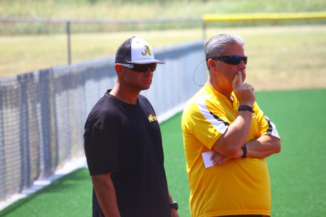 Head coach Dan Davis and assistant coach Elmer Mason evaluate players on the Army Gold squad July 27, 2019, during a game. They will finalize their roster this week. Both have years of experience as players on the All-Army softball team winning gold at the All-Armed Forces Softball Championship tournament.