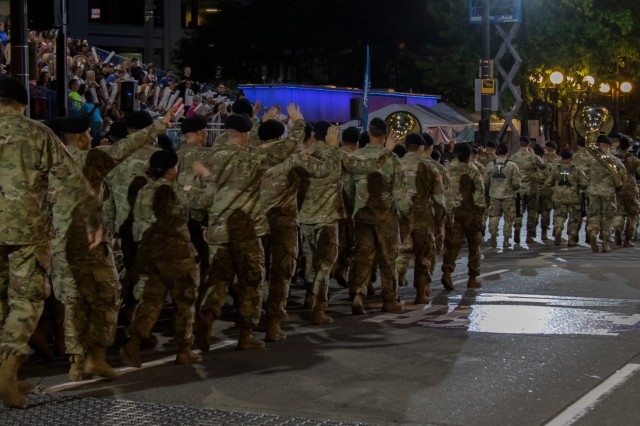 Soldiers from Joint Base Lewis-McChord participate in the Seafair Alaska Airlines Torchlight Parade in Seattle July 27.