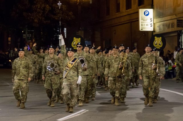 Led by America's I Corps Army Band, Soldiers from Joint Base Lewis-McChord participate in the Seafair Alaska Airlines Torchlight Parade in Seattle, July 27.