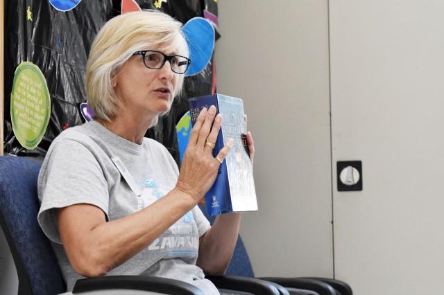 Malinda Martin, a volunteer, teaches a Bible lesson during Vacation Bible School at Camp Zama, Japan, July 31.