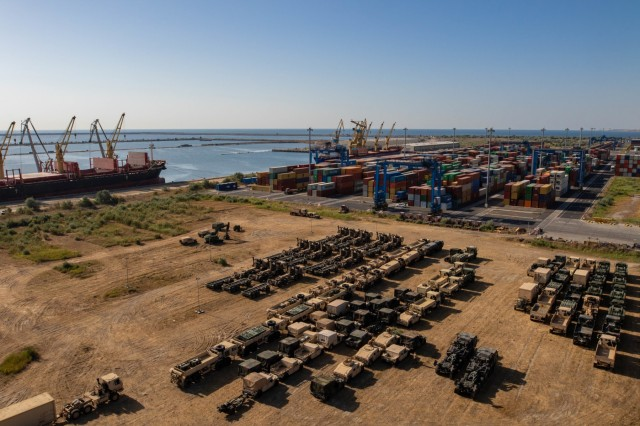 The staging area holds all the overflow vehicles that must get ready for shipment back to the United States at the Port of Constanta, Romania, July 1, 2019. The vehicles were separated according to whether they are being shipped at the end of July or the beginning of August. Movement control teams track the progress of redeployment, including which vehicles have been biocleaned and have passed customs inspections. (U.S. Army photo by Pfc. Laurie Ellen Schubert, 5th Mobile Public Affairs Detachment)
