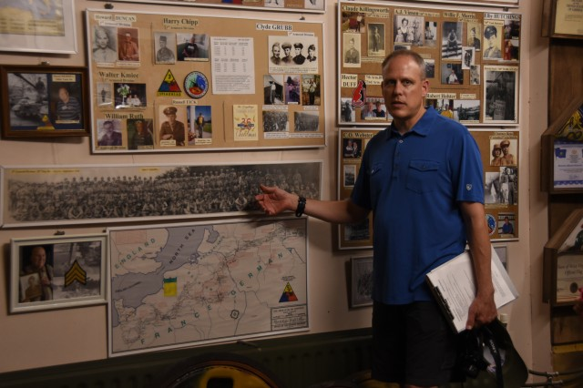 U.S. Army Garrison Benelux's Religious Support Office Soldiers and their families visited the Remember Museum 39-45 Thimister-Clermont, Belgium, July 25, 2019, for unit training. During the visit, Chaplain (Lt. Col.) Kelly Porter, garrison chaplain, talked about Operation Market Garden by pointing to locations on a map and explaining the paths the militaries used for the operation.