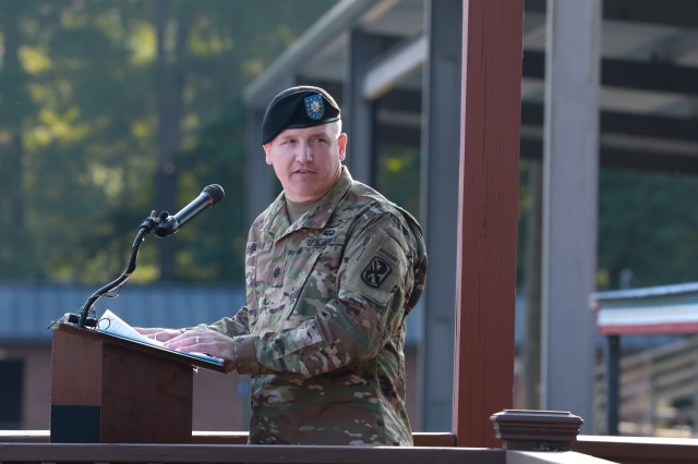 FORT BENNING, Ga. - Lt. Col. Patrick Flynn, commander of the newly activated 3rd Battalion, 54th Infantry Regiment, delivers remarks following his unit's activation. In a morning ceremony on Kanell Field, 3rd Bn., 54th Infantry Regt., was activated July 31 at Sand Hill here to fulfill its mission of training new Infantry Soldiers. (U.S. Army photo by Markeith Horace, Maneuver Center of Excellence, Fort Benning Public Affairs)