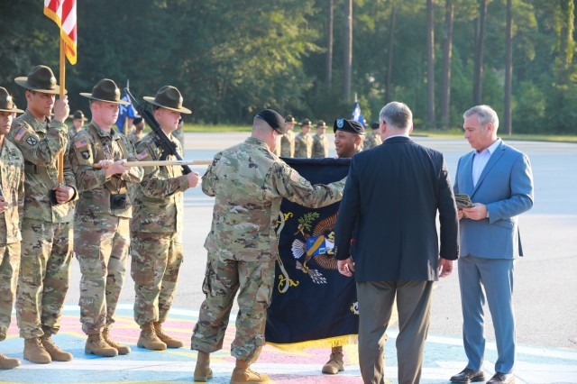 FORT BENNING, Ga. - Lt. Col. Patrick Flynn, center left, and Command Sgt. Maj. Billy Way, center right, uncase the unit colors of 3rd Battalion, 54th Infantry Regiment, with the help of retired Col. Chris Forbes, second from right, and retired Command Sgt. Maj. Darrin Bohn, far right. In a morning ceremony on Kanell Field, 3rd Battalion, 54th Infantry Regiment, was activated July 31 at Sand Hill here to fulfill its mission of training new Infantry Soldiers. (U.S. Army photo by Markeith Horace, Maneuver Center of Excellence, Fort Benning Public Affairs)