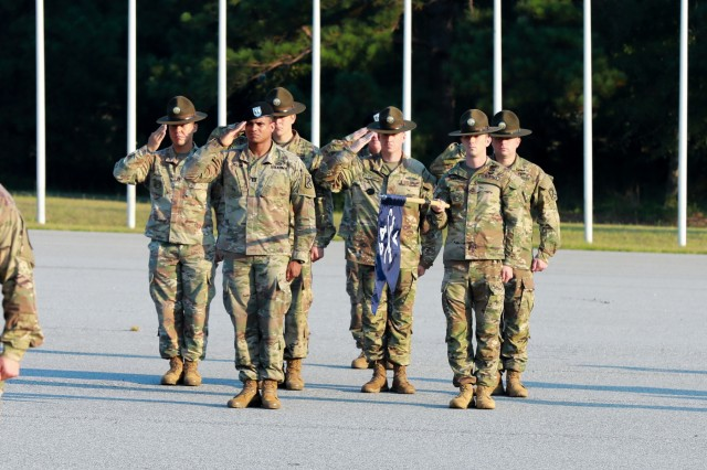 FORT BENNING, Ga. - Members of Alpha Company, 3rd Battalion, 54th Infantry Regiment, 198th Infantry Brigade, salute during a pass in review during the activation of 3-54. In a morning ceremony on Kanell Field, 3rd Battalion, 54th Infantry Regiment, was activated July 31 at Sand Hill here to fulfill its mission of training new Infantry Soldiers. Alpha Company is the first company of 3-54 scheduled to train new Infantry Soldiers. (U.S. Army photo by Markeith Horace, Maneuver Center of Excellence, Fort Benning Public Affairs)