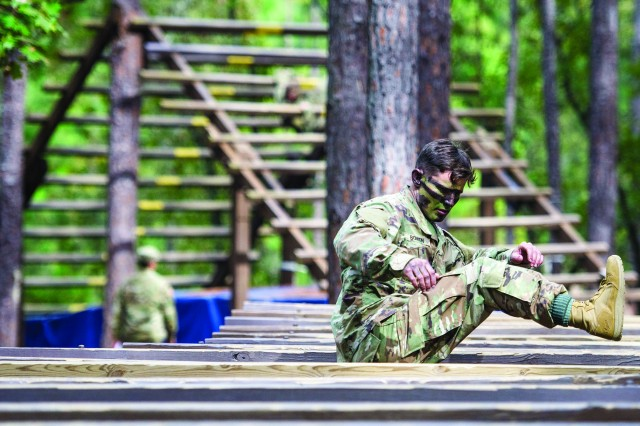Staff Sgt. Dakota Bowen, a drill sergeant with 3rd Battalion, 39th Infantry Regiment, traverses an obstacle during the Fort Jackson Best Warrior Competition. Bowen began his journey in competition to be named the best. After winning the Fort Jackson Best Warrior Competition, he went on to compete and win at the TRADOC level. Bowen will compete again later this year for the highest honor of Department of the Army Best Warrior competition.