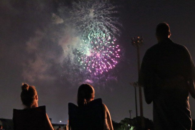 CAMP ZAMA, Japan - Command Sgt. Maj. Neil Sartain, Memphis, Tennessee native, 38th Air Defense Artillery Brigade senior enlisted advisor, his wife Paula, and daughter Natalie, enjoy the fireworks during the closing of the 60th Annual Camp Zama Bon Odori Festival, Aug. 3, 2019. This marks the first time Pacific Guardian Soldiers participated in the festival, which served to learn more about Japanese culture and share that experience with their host-nation neighbors.