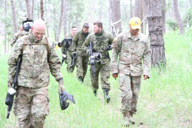 The 41 Canadian Brigade Group and the Danish Home Guard exit the Urban Patrol Lane during the Golden Coyote Training Exercise, June 14, 2019, West Camp Rapid, Rapid City, S.D. After the exercise troops regroup and perform an After Action Review to aid in future training.