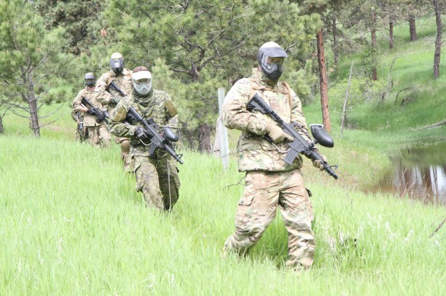 The 41 Canadian Brigade Group and the Danish Home Guard conduct a simulated reconnaissance mission on the Urban Patrol Lane during the Golden Coyote Training Exercise, June 14, 2019, West Camp Rapid, Rapid City, S.D. The Urban Patrol Lane provides the building blocks for small element infantry tactics using paintball guns for the simulation.