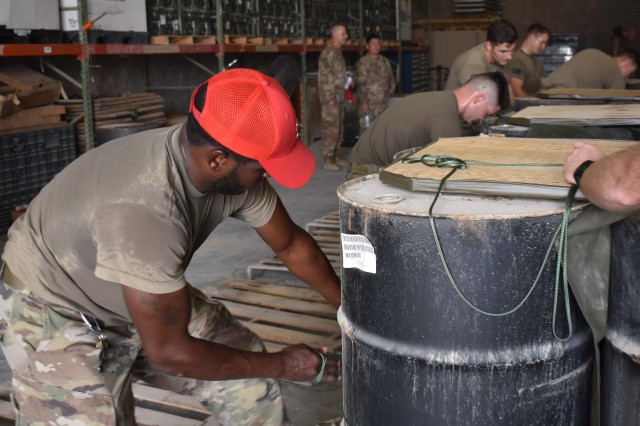 Soldiers of the 861st Quartermaster Company, U.S. Army Reserve, operating in Qatar under the 77th Sustainment Brigade, have been preparing aerial drops for delivery across the U.S. Central Command area of operations. (U.S. Army Reserve photo by Staff Sgt. David Clemenko)