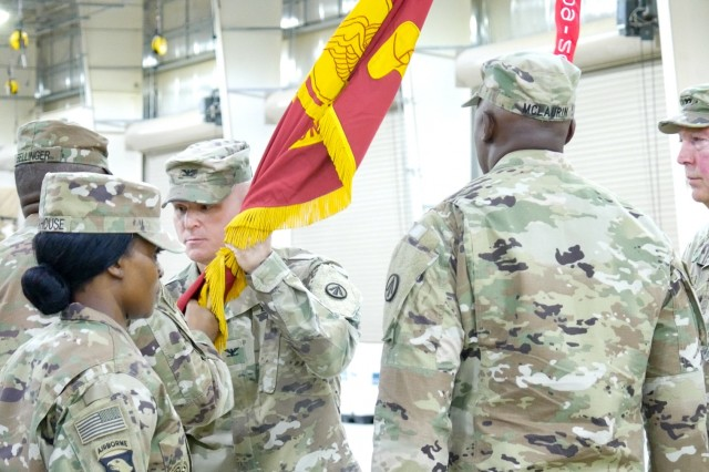 Col. Michael T. Moore, outgoing commander of the 595th Transportation Brigade, receives the unit colors during a change of command ceremony at Camp Arifjan, Kuwait, Aug. 1, 2019. (U.S. Army National Guard photo by Staff Sgt. Veronica McNabb)