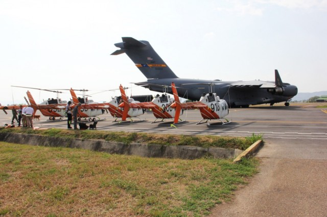Five TH-67 aircraft wait on the tarmac at Bogota El Dorado International Airport, Military Air Base for further transfer to Colombia Rotary Wing Helicopter Training Center in Melgar, Colombia.