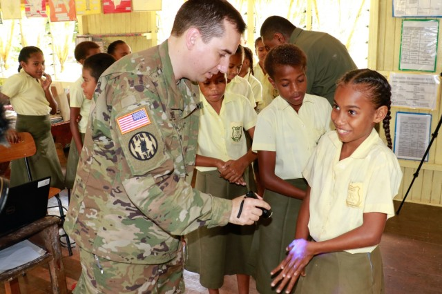 U.S. Army Capt. Gavin Devries, who serves in the 351st Civil Affairs Command, as a civil affairs officer, goes through a practical exercise with students on the importance of proper hand washing during a civil and community outreach activity at Ululbau District School in Labasa, Fiji, July 31, 2019. Bilateral exercises, such as Exercise Cartwheel, strengthen our nations' capabilities to respond to crisis situations. The U.S. Army is committed to maintaining a long lasting relationship with its Fijian partners in the Pacific. (U.S. Army Photo by 1st Lt. Mark Sagvold)