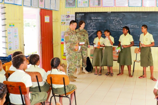 U.S. Army Capt. Sarah Robinson and Capt. Gene Choi, who serve in the 351st Civil Affairs Command, as civil affairs officers, teach healthy eating during civil and community outreach activities at Ululbau District School in Labasa, Fiji, July 31, 2019. Bilateral exercises, such as Exercise Cartwheel, strengthen our nations' capabilities to respond to crisis situations. The U.S. Army is committed to maintaining a long lasting relationship with its Fijian partners in the Pacific.(U.S. Army Photo by 1st Lt. Mark Sagvold)