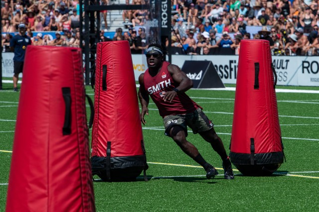 Capt. Chandler Smith, a member of the U.S. Warrior Fitness Team, competes in the men's individual competition at the 2019 CrossFit Games in Madison, Wis., Aug. 3, 2019. During the sprint event, competitors had to complete an out-and-back race across Field. Upon their return, athletes had to cut through several tight turns before crossing the finish line.