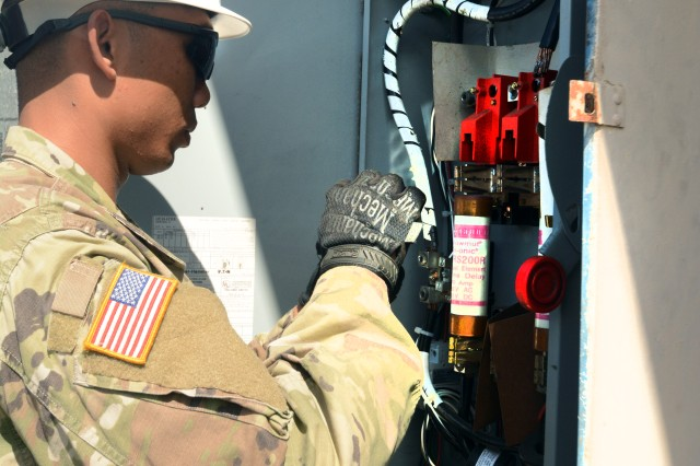 A 249th Engineer Battalion (Alpha Company) 3rd Power Station Prime Power Specialist Pfc. Hung Nguyen assesses a fuse box June 21, as a culmination of months of training and preparation. The 3rd Power Station conducted a platoon training exercise readies to assume its role as Primary National Response Framework (NRF) platoon by conducting an assessment of the Honolulu District U.S. Army Corps of Engineers Emergency Operations Center.