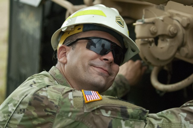 U.S. Army Reserve Staff Sgt. Brett Cosaboom with the Regional Training Site Maintenance Company in Fort McCoy, Wis., prepares a truck during an equipment recovery exercise at Fort McCoy July 20, 2019.