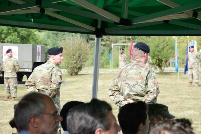 Col. Mark Swofford (left), outgoing commander, and incoming commander, Col. E. Lee Bryan (right), stand in parade rest during a change of command and change of responsibility ceremony, Aug. 6, 2019, at Rose Barracks in Vilseck, Germany. Col. Bryan and Command Sgt. Maj. Kasandra Boulier formally accepted the command team reins of the U.S. Army Medical Department Activity Bavaria from Col. Swofford and Command Sgt. Maj. Michael Bivins.