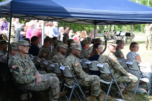 Members and senior leaders of U.S. Army Garrison Bavaria observe the change of command and change of responsibility ceremony, Aug. 6, 2019, at Rose Barracks in Vilseck, Germany. Col. E. Lee Bryan and Command Sgt. Maj. Kasandra Boulier formally accepted the command team reins of the U.S. Army Medical Department Activity Bavaria from Col. Mark Swofford and Command Sgt. Maj. Michael Bivins.