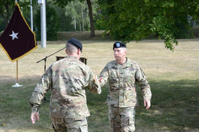 Col. Mark Swofford (right), outgoing commander, welcomes Col. E. Lee Bryan, incoming commander, as the new commander of the U.S. Army Medical Department Activity Bavaria during a change of command and change of responsibility ceremony, Aug. 6, 2019, at Rose Barracks in Vilseck, Germany. Col. Bryan and Command Sgt. Maj. Kasandra Boulier formally accepted the command team reins of the U.S. Army MEDDAC Bavaria from Col. Swofford and Command Sgt. Maj. Michael Bivins.