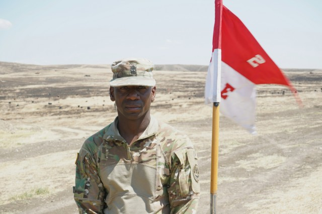 U.S. Army 1st. Sgt. Timothy Simmons, assigned to Eagle Troop, 2d Squadron, 2d Cavalry Regiment, serves as the troop's first sergeant, poses for a photo before leading his troops on their second platoon live-fire exercise during Agile Spirit 19 at the Vaziani Training Area, near Tbilisi, Georgia, Aug. 1, 2019. AgS19 is a cooperatively led exercise between the Georgian Defense Forces and U.S. Army Europe, designed to support theater security cooperation and training efforts among the 14 allies and partnering nations participating. The exercise is designed to improve joint and multinational readiness, interoperability, mobility and posture of combat credible forces across the European theater specifically in Georgia. (U.S. Army photo by Sgt. LaShic Patterson)