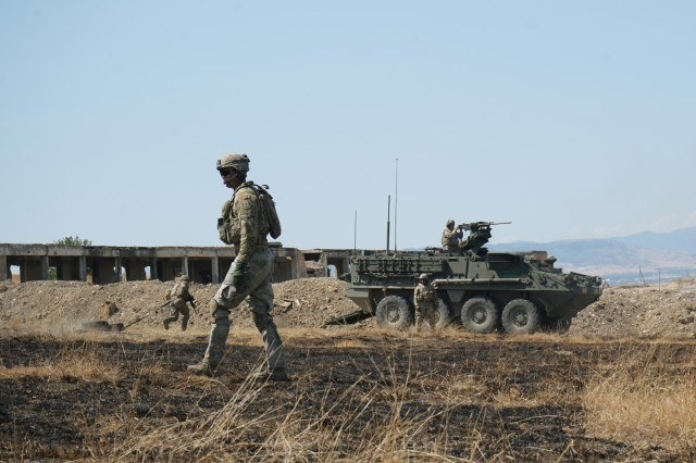 U.S. Soldiers, assigned to Eagle Troop, 2d Squadron, 2d Cavalry Regiment, assist with carrying a mock casualty to the 30mm Stryker Infantry Carrier Vehicle, Dragoon, for the platoon live-fire exercise during Agile Spirit 19 at the Vaziani Training Area near Tbilisi, Georgia, Aug. 1, 2019. AgS19 is a cooperatively led exercise between the Georgian Defense Forces and U.S. Army Europe, designed to support theater security cooperation and training efforts among the 14 allies and partnering nations participating. The exercise is designed to improve joint and multinational readiness, interoperability, mobility and posture of combat credible forces across the European theater specifically in Georgia. (U.S. Army photo by Sgt. LaShic Patterson)