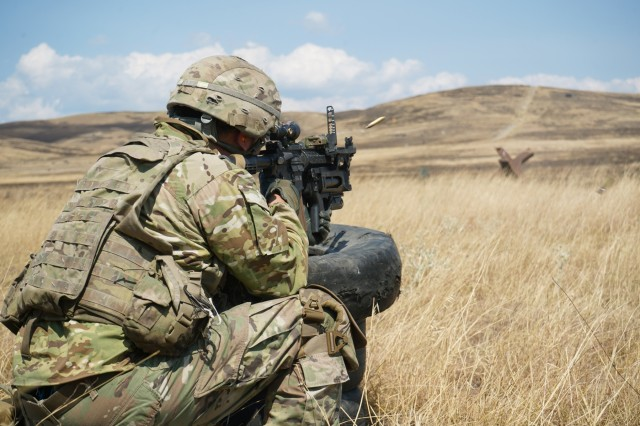 U.S. Army Cpl. Austin Smith, assigned to Eagle Troop, 2d Squadron, 2d Cavalry Regiment, fires an M249 squad automatic weapon for the platoon live-fire exercise during Agile Spirit 19 near Tbilisi, Georgia, Aug. 1, 2019. AgS19 is a cooperatively led exercise between the Georgian Defense Forces and U.S. Army Europe, designed to support theater security cooperation and training efforts among the 14 allies and partnering nations participating. The exercise is designed to improve joint and multinational readiness, interoperability, mobility and posture of combat credible forces across the European theater specifically in Georgia. (U.S. Army photo by Sgt. LaShic Patterson)