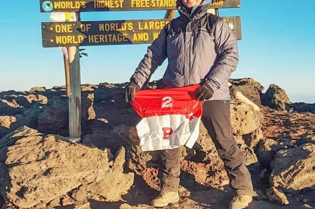 U.S. Army Sgt. 1st Class Andrew Shepherd, senior enlisted advisor, Palehorse Troop, 4th Squadron, 2d Cavalry Regiment, displays his troop's guidon atop Uhuru Peak, Tanzania, July 5, 2019. An avid outdoors man, Shepherd pursued his dream of climbing Mount Kilimanjaro. The peak, which is 5,895 meters above sea level and is the tallest in Africa, took him five days in total to ascend. (U.S. Army photo by Sgt. 1st Class Andrew Shepherd, 2d Cavalry Regiment)