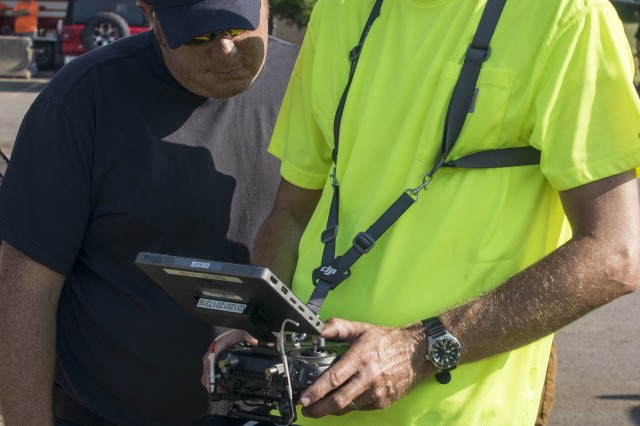 Jamie Davis (right), with the Ohio Department of Transportation Unmanned Aerial Systems Center, captures aerial video surveillance of an incident site for the West Licking Joint Fire District during Vigilant Guard 19-4, Aug. 5, 2019, at the Ohio Fire Academy in Reynoldsburg, Ohio. Vigilant Guard brings together over 3,000 personnel from over 90 local, state and federal agencies to train and develop disaster response capabilities in the largest exercise of its kind in the state's history.