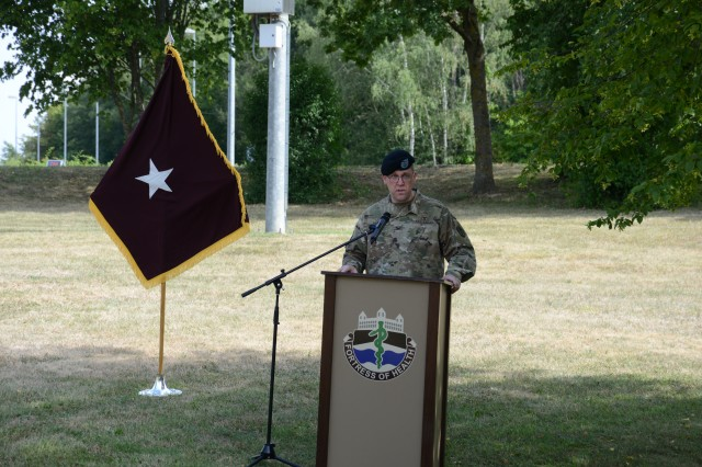 Col. E. Lee Bryan, incoming commander, addresses the crowd in attendance for the first time as the new commander of U.S. Army Medical Department Activity Bavaria during a change of command and change of responsibility ceremony, Aug. 6, 2019, at Rose Barracks in Vilseck, Germany. Col. Bryan and Command Sgt. Maj. Kasandra Boulier formally accepted the command team reins of the U.S. Army MEDDAC Bavaria from Col. Swofford and Command Sgt. Maj. Michael Bivins.