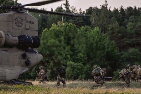 U.S. Army paratroopers assigned to 91st Cavalry Regiment, 173rd Airborne Brigade, exit a CH-47 Chinook helicopter while participating in Exercise Saber Screen, July 22, 2019.