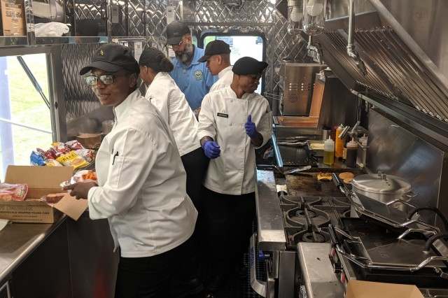 Culinary specialists from the 10th Mountain Division will introduce the Fort Drum community to the U.S. Army Food Service's newest food truck during a grand opening Aug. 8 at Clark Hall. The crew spent two weeks training on the Culinary Outpost food truck in preparation, and will begin food service operations at various locations where Soldiers are far-removed from dining facilities and kiosks on post. (Photo by Mike Strasser, Fort Drum Garrison Public Affairs)