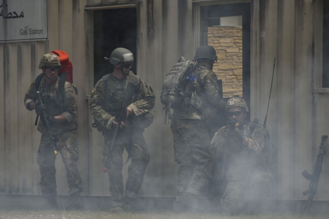 U.S. Army Soldiers secure a location during the Regional Health Command Atlantic Best Medic Competition at Joint Base Langley-Eustis, Va., July 31, 2019. The care under fire event tasked competitors with locating their patient, administering care and evacuating casualties while maintaining their own personal security.