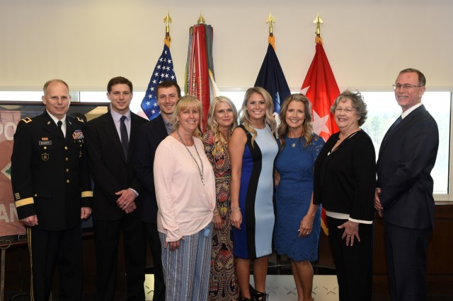 Maj. Gen. Allan Elliott and his family prior to his March 28 retirement ceremony. Elliott retired as the chief of staff for the Army Materiel Command. (U.S. Army Photo by Doug Brewster)
