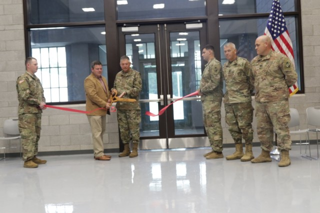 Columbia Mayor Justin Mckenzie and Maj. Gen. Janson D. Boyles, the adjutant general of Mississippi, cut the ribbon to officially reopen the Columbia Army National Guard Readiness Center July 13 while Lt. Col. Paul Lyon, 150th Brigade Engineer Battalion commander, and Capt. Shane Edgar, Company A, 150th BEB commander, look on. Company A Specs. Nicholas Smith and Preston Foster held the ribbon. The center, home to Company A, was reopened after being destroyed on Dec. 23, 2014, by a tornado.