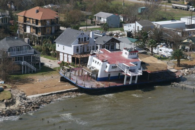 GALVESTON, Texas (September 20, 2008)—A boat is seen washed up on shore in front of a home on the coast of Galveston after Hurricane Ike made landfall September 13, 2008 as a category 2 hurricane with wind speeds of around 110 MPH causing massive flooding and wind damage. (Photo by USACE Galveston District)
