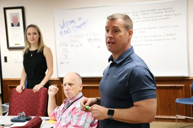 Col. Brian Cook, Army Futures Command's lead campaign planner, leads a discussion during a planning workshop in Austin, Texas, July 25, 2019. The workshop was held by Army Futures Command planners to gather input from subordinate units in the development of the command's first multi-year Enterprise Campaign Plan.