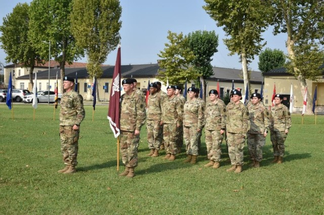 Lt. Col. Leif O. Ibsen, incoming commander of Public Health Activity - Italy, takes the command, during the change of command ceremony at Caserma C. Ederle in Vicenza, Italy, July 30, 2019.