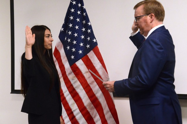 Oregon District Attorney for Deschutes County John Hummel (right), administers the oath of office to Jasmyn Troncoso (left) as she becomes the newest deputy district attorney for Deschutes County, Aug. 5, 2019, at the Oregon Youth ChalleNGe Program (OYCP) campus, Bend, Oregon. Troncoso graduated from OYCP in 2006 and credits the program to help change her life and desire to become an attorney.