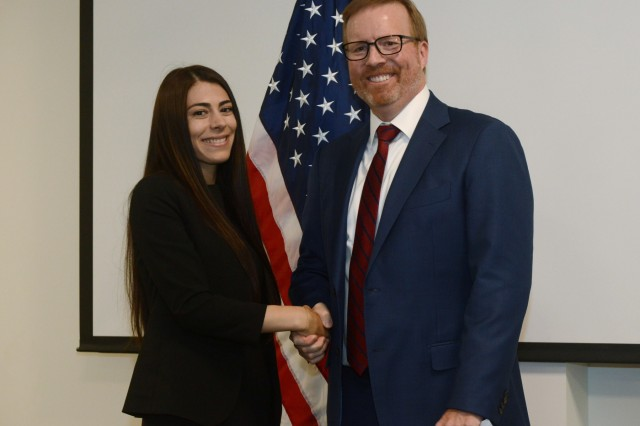 Oregon District Attorney for Deschutes County John Hummel (right), congratulates Jasmyn Troncoso (left) after she completes the oath of office as she becomes the newest deputy district attorney for Deschutes County, Aug. 5, 2019, at the Oregon Youth ChalleNGe Program (OYCP) campus, Bend, Oregon. Troncoso graduated from OYCP in 2006 and credits the program to help change her life and the desire to become an attorney.