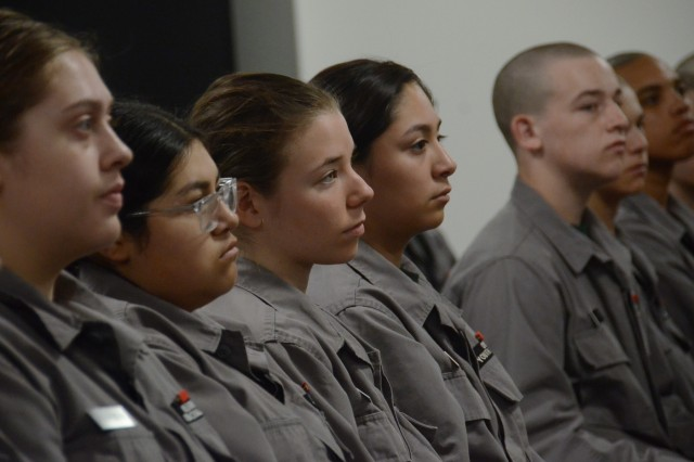 Cadets of the Oregon Youth Challenge Program list to remarks by Jasmyn Troncoso during her ceremony, as she becomes the newest deputy district attorney for Deschutes County, Aug. 5, 2019, at the Oregon Youth ChalleNGe Program (OYCP) campus, Bend, Oregon. Troncoso graduated from OYCP in 2006 and credits the program to help change her life and desire to become a lawyer. )