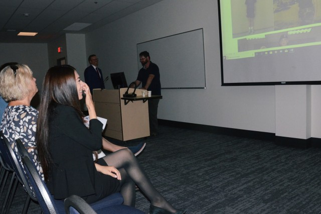 Jasmyn Troncoso watches a slide show of images from her time as a cadet at the Oregon Youth Challenge Program campus during her ceremony as she becomes the newest deputy district attorney for Deschutes County, Aug. 5, 2019, at the Oregon Youth ChalleNGe Program (OYCP) campus, Bend, Oregon. Troncoso graduated from OYCP in 2006 and credits the program to help change her life and desire to become an attorney.