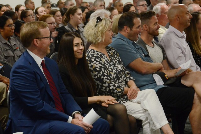 Oregon District Attorney for Deschutes County John Hummel (left), and Jasmyn Troncoso (right), and cadets of the Oregon Youth ChalleNGe program listen to remarks from Oregon Secretary of State Beverly Clarno, at the OYCP campus, Aug. 5, 2019.