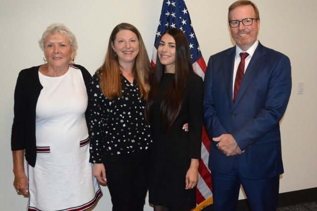 (Left to right) Oregon Sec. of State Beverly Clarno along with Jenny Marrow, Jasmyn Troncoso and John Hummel, District Attorney for Deschutes County, gather for a photograph together following Ms. Troncoso's ceremony as the newest deputy district attorney for Deschutes County, Aug. 5, 2019, at the OYCP campus, Bend, Oregon.