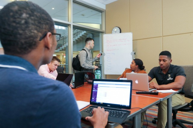 Capt. Alex Pytlar works with cadets during the Hacking for Defense course. Hacking for Defense is a graduate level course currently taught at 22 universities throughout the country. During the course, students learn problem solving skills while working to find solutions to Department of Defense problems.