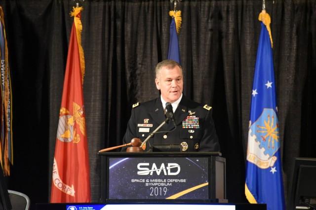 Lt. Gen. James H. Dickinson, commanding general, U.S. Army Space and Missile Defense Command, speaks at the 22nd Space and Missile Defense Symposium at the Von Braun Center, Huntsville, Alabama, Aug. 6. (U.S. Army photo by Dottie K. White)