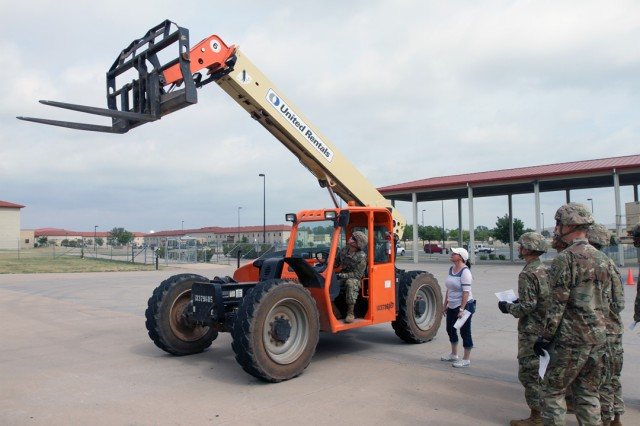 AIT student Pvt. Matthew Blanton practices using the lift on a Class 7 forklift Aug. 3, 2019, outside McClymont Hall. Great Plains Technology Center safety instructor Cherri Lambert provided instructions on operating it.