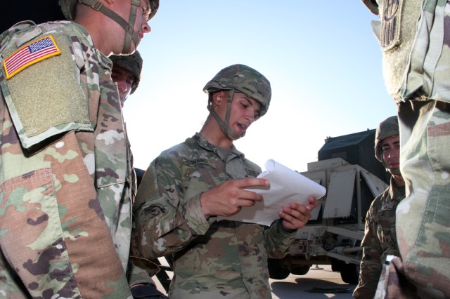 Pvt. Jeremy Ward, a 14E AIT students in Class No. 504-19E, reads Patriot missile emplacement drills to his fellow students, during a field training exercise at Fort Sill, Okla., July 31, 2019.